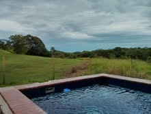 REDUCED!!Large titled land with house and pool in Costa Esmeralda
