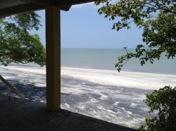 Beachfront lot with small house for sale in Juan Hombron